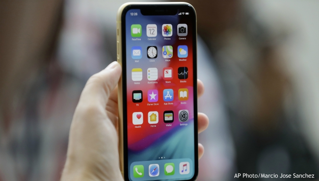 FILE - This Sept. 12, 2018, file photo shows an Apple iPhone XR on display at the Steve Jobs Theater after an event to announce new products, in Cupertino, Calif. (AP Photo/Marcio Jose Sanchez, File)