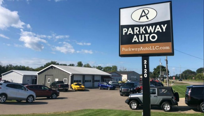 Parkway auto sign above vehicle lot