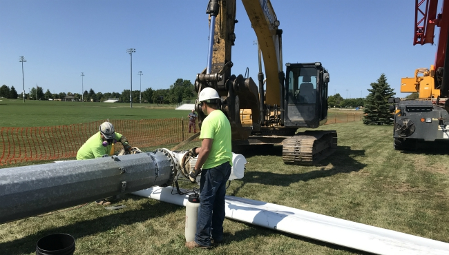 An Aug. 1, 2019 photo shows crews working to remove wind turbines from Helder Park in Zeeland.