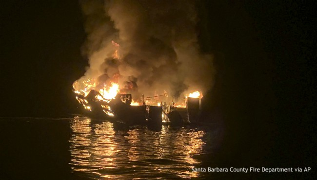 burning boat on water