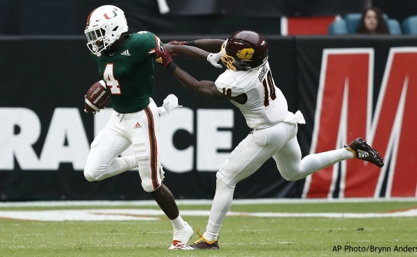Miami wide receiver Jeff Thomas (4) avoids the tackle by Central Michigan defensive back Montrae Braswell (10) during the first half of an NCAA college football game, Saturday, Sept. 21, 2019, in Miami Gardens, Fla. (AP Photo/Brynn Anderson)