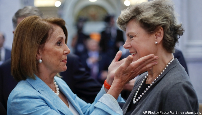 FILE - In this Sept. 14, 2016, file photo, House Democratic Leader Nancy Pelosi, left, of Calif., greets journalist Cokie Roberts, right, in the Great Hall of the Library of Congress in Washington. Roberts, a longtime political reporter and analyst at ABC News and NPR has died, ABC announced Tuesday, Sept. 17, 2019. She was 75. (AP Photo/Pablo Martinez Monsivais)