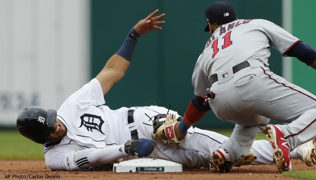 Detroit Tigers' Victor Reyes, left, safely beats the tag of Minnesota Twins shortstop Jorge Polanco (11) at second base for a steal during the first inning of a baseball game, Sunday, Sept. 1, 2019, in Detroit. (AP Photo/Carlos Osorio)