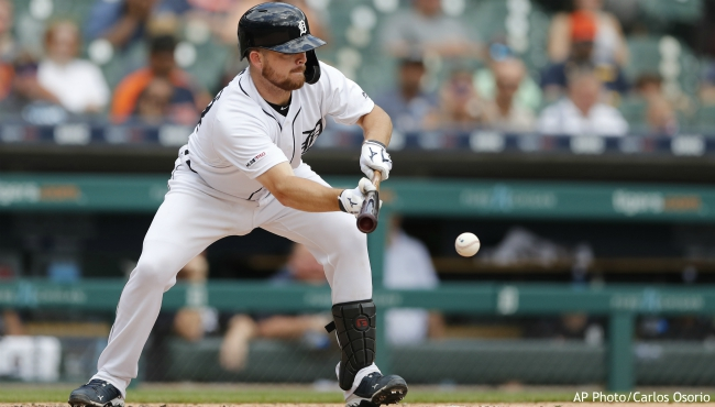 Detroit Tigers' Jake Rogers bunts during the fifth inning of a baseball game against the Minnesota Twins, Monday, Sept. 2, 2019, in Detroit. (AP Photo/Carlos Osorio)