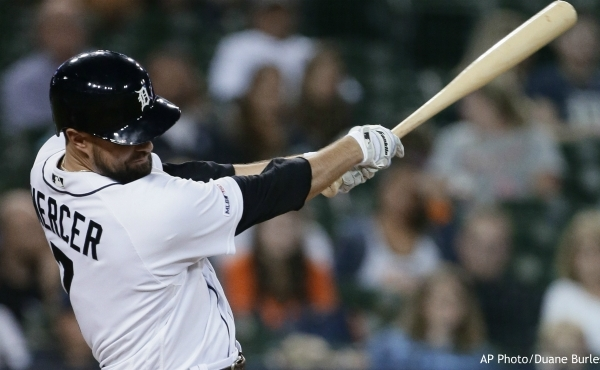 Detroit Tigers' Jordy Mercer singles to drive in a run against the Baltimore Orioles during the sixth inning of a baseball game Friday, Sept. 13, 2019, in Detroit. (AP Photo/Duane Burleson)