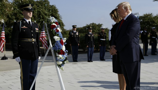 President Donald Trump and first lady Melania Trump pause after placing a wreath and will participate in a moment of silence honoring the victims of the Sept. 11 terrorist attacks, Wednesday, Sept. 11, 2019, at the Pentagon. (AP Photo/Evan Vucci)