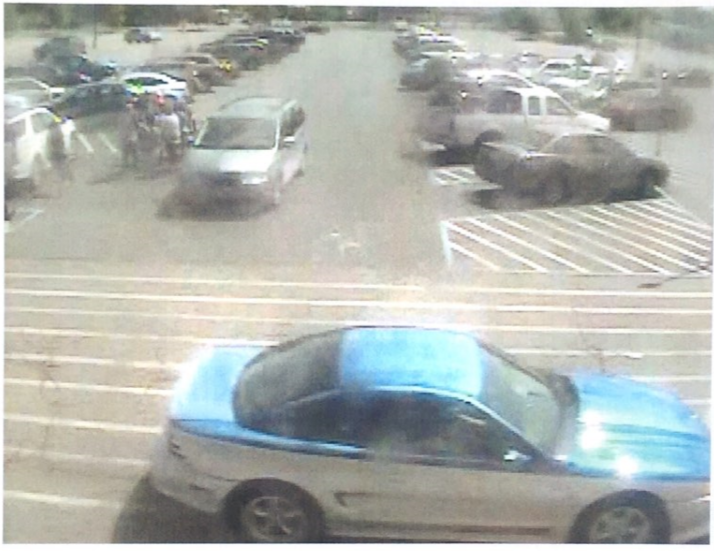 A surveillance photo of a suspect's vehicle in connection to a bank card fraud. (Michigan State Police)