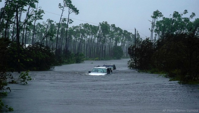 Submerged car sit submerged in water from Hurricane Dorian in Freeport, Bahamas.