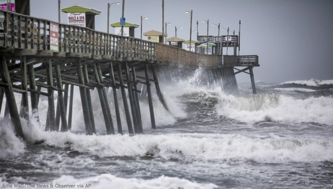 Waves pound the Bogue Inlet Fishing Pier in Emerald Isle, N.C.,as Hurricane Dorian moves north off the coast. (Julia Wall/The News & Observer via AP)