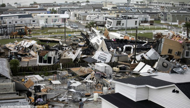 Mobile homes are upended and debris is strewn about at the Holiday Trav-l Park, Thursday, Sept. 5, 2019, in Emerald Isle, N.C, after a possible tornado generated by Hurricane Dorian struck the area. (Julia Wall/The News & Observer via AP)