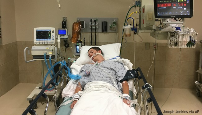 Man lying in hospital bed