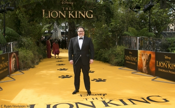 FILE - In this July 14, 2019 file photo, director Jon Favreau poses for photographers upon arrival at the 'Lion King' European premiere in central London. Hollywood's summer season came to a close Sunday, Sept. 1 with a whimper. The Labor Day weekend is traditionally a quiet one for movie theaters. The Walt Disney Co. accounted for about half of all ticket sales in U.S. and Canada theaters. (Photo by Joel C Ryan/Invision/AP, File)