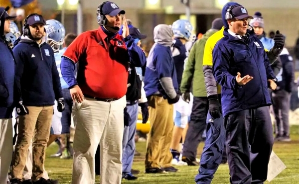 Mike Koziak, in red, and Matt Koziak, in blue, coaching during the 2018 season.