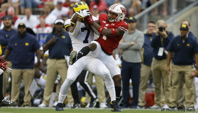 Wisconsin linebacker Spencer Lytle, right, breaks up a pass intended for Michigan wide receiver Tarik Black during the second half of an NCAA college football game Saturday, Sept. 21, 2019, in Madison, Wis. Wisconsin won 35-14. (AP Photo/Andy Manis)