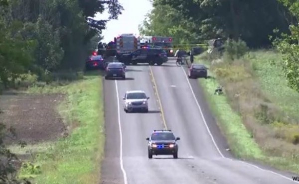 Emergency vehicles with lights on move down hill