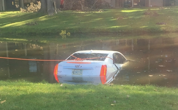 A car in a pond near the Aspen Lakes Apartments in Grand Rapids. (Sept. 18, 2019)