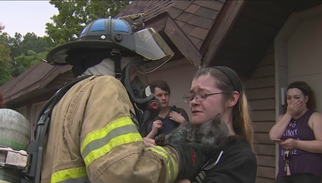 Woman overjoyed when cat gets rescued from fire