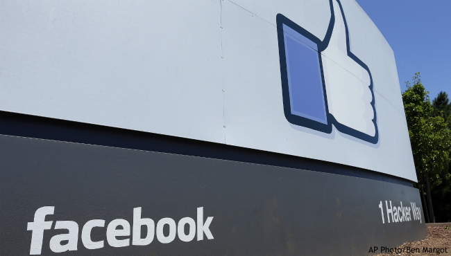 FILE - This July 16, 2013, file photo, shows a sign at Facebook headquarters in Menlo Park, Calif.(AP Photo/Ben Margot, File)