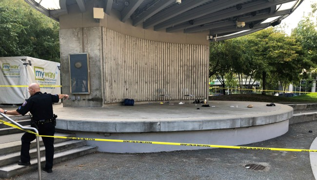 Police examining stage at Rosa Parks Circle after stabbing