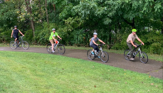 Four bicyclists on trail