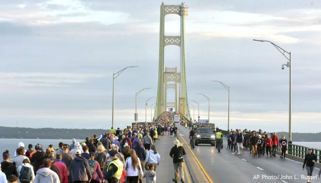 people walk down mackinac bridge