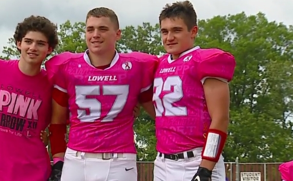 A photo of friends Grant Pratt and Grady McDonald standing together at the Pink Arrow Pride game in Lowell. (Sept. 13, 2019)