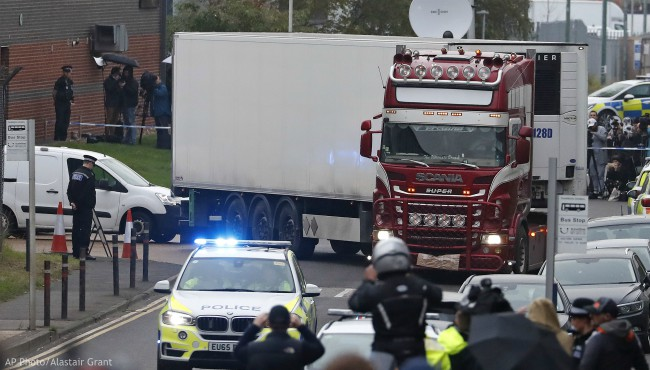 Police escort the truck, that was found to contain a large number of dead bodies, as they move it from an industrial estate in Thurrock, south England, Wednesday Oct. 23, 2019. (AP Photo/Alastair Grant)