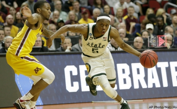 FILE - In this March 23, 2019, file photo, Michigan State's Cassius Winston (5) drives past Minnesota's Dupree McBrayer (1) during the second half of a second round men's college basketball game in the NCAA Tournament, in Des Moines, Iowa. Cassius Winston is the unanimous pick for Big Ten Preseason Player of the Year. The vote by media announced Wednesday, Oct. 2, 2019, was hardly a surprise considering Winston was selected Big Ten Player of the Year last season. (AP Photo/Nati Harnik, File)