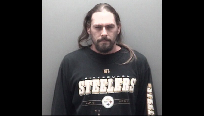A booking photo of Christopher McMillan. (Courtesy of the Eaton County Sheriff's Office)