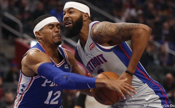 Philadelphia 76ers forward Tobias Harris (12) reaches in on Detroit Pistons forward Markieff Morris during the first half of an NBA basketball game, Saturday, Oct. 26, 2019, in Detroit. (AP Photo/Carlos Osorio)