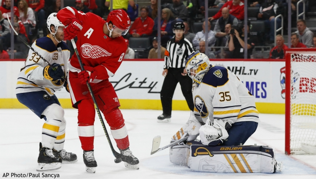 Buffalo Sabres goaltender Linus Ullmark (35) stops a shot by Detroit Red Wings center Frans Nielsen (81) in the second period of an NHL hockey game Friday, Oct. 25, 2019, in Detroit. (AP Photo/Paul Sancya)