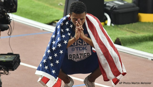 Donavan Brazier squatting with flag on his back