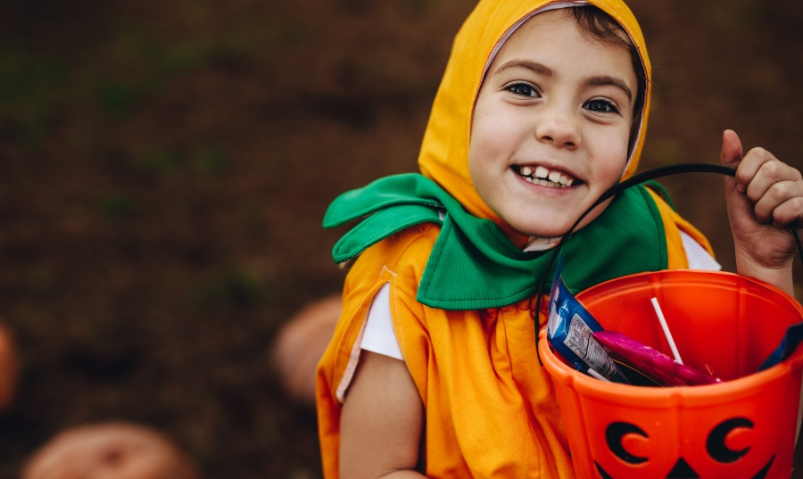Little girl in costume trick or treating.
