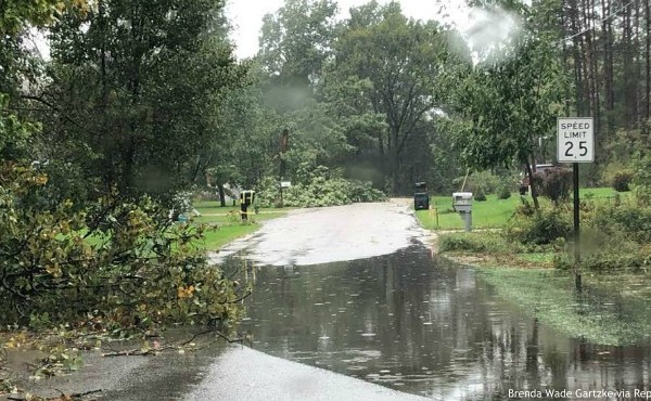 A flooded road and downed trees near Indian Lake in Howard City Tuesday, Oct. 1, 2019. (Brenda Wade Gartzke via ReportIt)