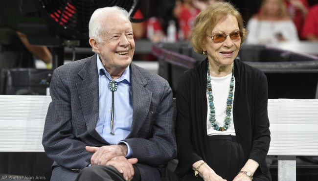In this Sept. 30, 2018 file photo, former President Jimmy Carter and Rosalynn Carter are seen ahead of an NFL football game between the Atlanta Falcons and the Cincinnati Bengals, in Atlanta. (AP Photo/John Amis, File)