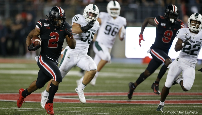 Ohio State running back J.K. Dobbins, left, outruns the Michigan State defense to score a touchdown during the first half of an NCAA college football game Saturday, Oct. 5, 2019, in Columbus, Ohio. (AP Photo/Jay LaPrete)