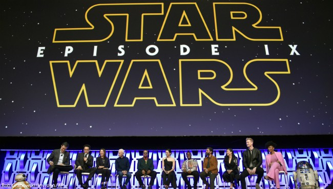 "In this April 12, 2019, file photo, Stephen Colbert, from left, J.J. Abrams, Kathleen Kennedy, Anthony Daniels, Billy Dee Williams, Daisy Ridley, John Boyega, Oscar Isaac, Kelly Marie Tran, Joonas Suotamo and Naomi Ackie participate in the ""Star Wars: The Rise of Skywalker"" panel on day 1 of the Star Wars Celebration at Wintrust Arena in Chicago. (Photo by Rob Grabowski/Invision/AP, File)"