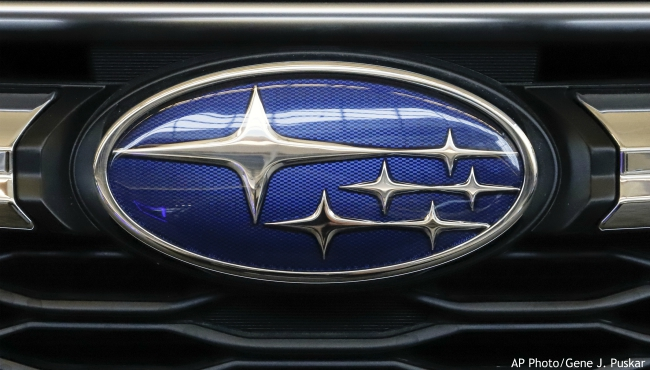 In this Feb. 14, 2019, file photo the Subaru logo on the front grill of a 2019 Subaru Impreza sedan is displayed at the 2019 Pittsburgh International Auto Show in Pittsburgh. Subaru is recalling over 400,000 vehicles in the U.S. to fix problems with engine computers and debris that can fall into motors. The first recall covers 466,000 Imprezas from 2017 through 2019, and 2018 and 2019 Crosstreks. (AP Photo/Gene J. Puskar, File)