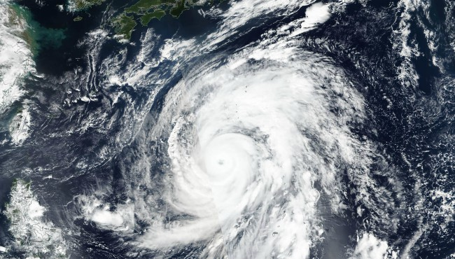 This Oct. 9, 2019, satellite photo taken by NASA-NOAA's Suomi NPP satellite shows typhoon Hagibis approaching Japan, top. (NASA Worldview, Earth Observing System Data and Information System (EOSDIS) via AP)