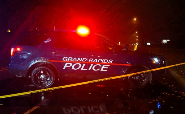 A photo of police at the scene of where a woman was hit by a car at Fuller Avenue and Knapp Street NE in Grand Rapids. (Oct, 26, 2019)