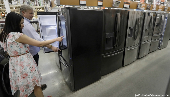 In this Sept. 23, 2019, photo shoppers examine refrigerators at a Home Depot store location, in Boston. On Wednesday, Oct. 16, the Commerce Department releases U.S. retail sales data for September. (AP Photo/Steven Senne)