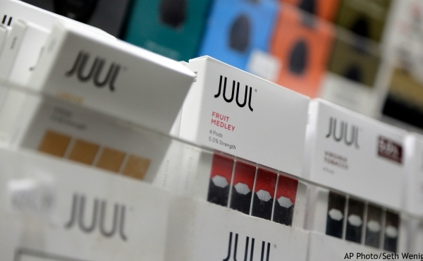 FILE - In this Dec. 20, 2018, file photo Juul products are displayed at a smoke shop in New York. On Thursday, Oct. 3, 2019, the U.S. Federal Trade Commission ordered Juul and five other vaping companies to hand over information about how they market e-cigarettes, the government's latest move targeting the industry. (AP Photo/Seth Wenig, File)