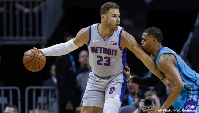 Detroit Pistons forward Blake Griffin, left, looks to pass the ball as Charlotte Hornets forward Miles Bridges during the first half of an NBA basketball game in Charlotte, N.C., Friday, Nov. 15, 2019. (AP Photo/Nell Redmond)