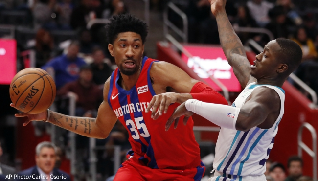 Detroit Pistons forward Christian Wood (35) looks to pass as Charlotte Hornets guard Terry Rozier defends during the first half of an NBA basketball game, Friday, Nov. 29, 2019, in Detroit. (AP Photo/Carlos Osorio)