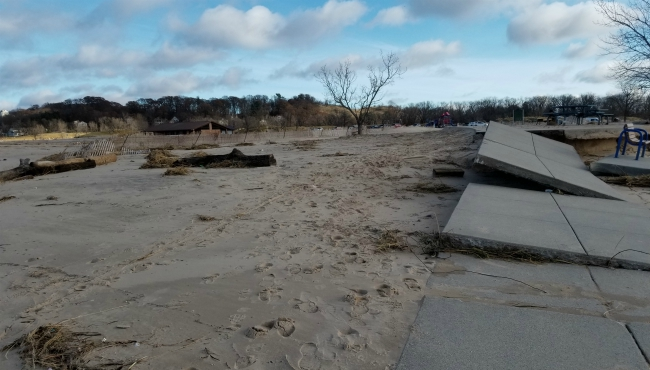 A photo of a sidewalk ripped up at Holland State Park on Nov. 28, 2019.