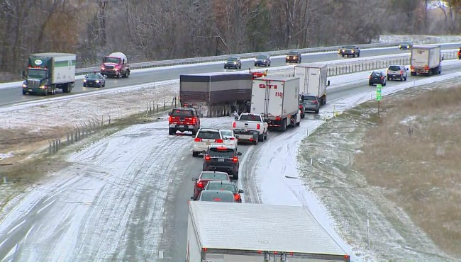 Traffic moves slowly on I-94 after a pileup near Paw Paw Friday, Nov. 8, 2019.