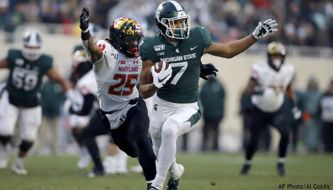 Michigan State's Cody White, right, is pursued by Maryland's Antoine Brooks Jr., left, after a pass reception during the first half of an NCAA college football game, Saturday, Nov. 30, 2019, in East Lansing, Mich. (AP Photo/Al Goldis)