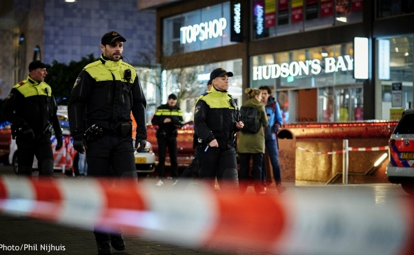 Dutch police secure a shopping street after a stabbing incident in the center of The Hague, Netherlands, Friday, Nov. 29, 2019. Dutch police say multiple people have been injured in a stabbing incident in The Hague's main shopping street. (AP Photo/Phil Nijhuis)