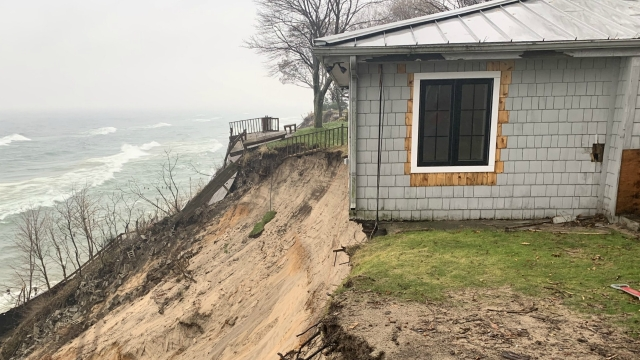 Officials: Home could drop into Lake Michigan any time