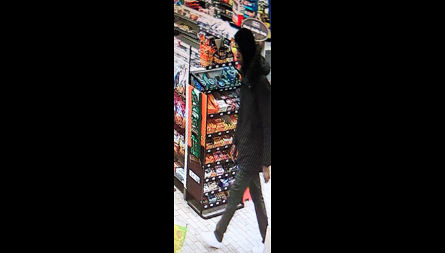 A surveillance photo of the suspect in connection to a robbery in Alpine Township Tuesday, Dec. 24, 2019.